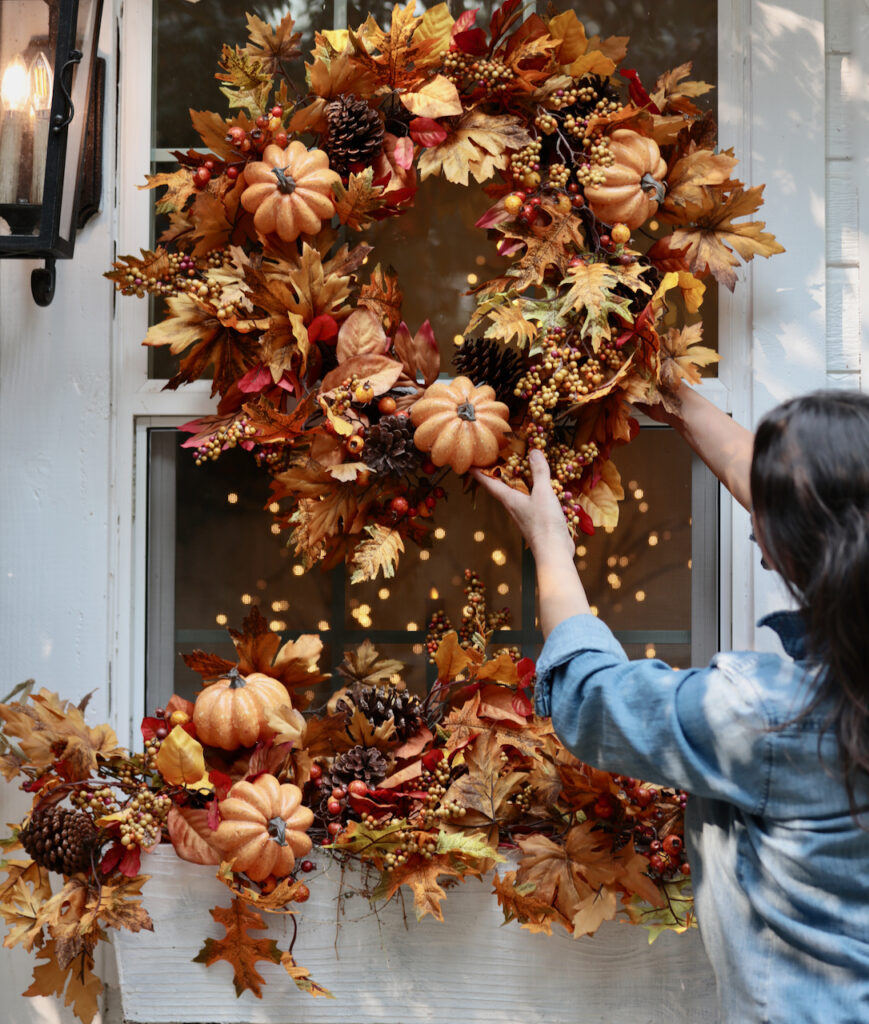 Courtney places fall wreath on window