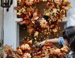 Courtney arranging fall garland