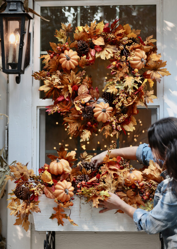 Courtney arranging fall garland