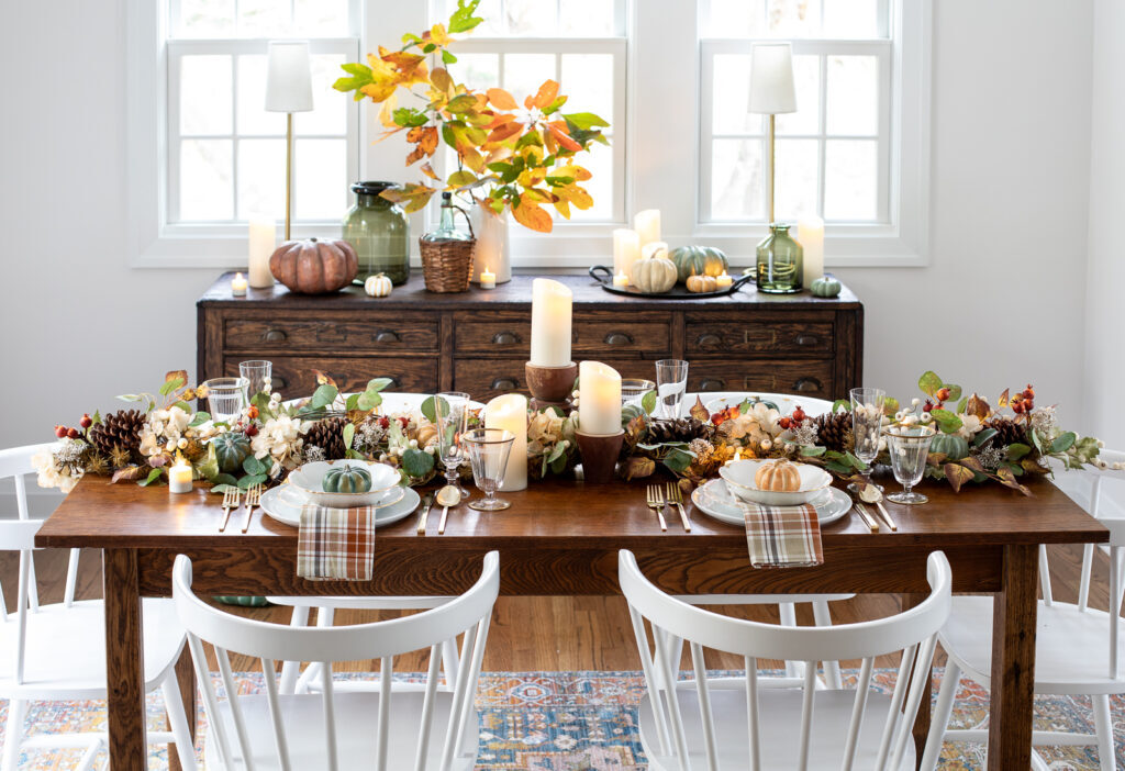 thanksgiving table-setting with artificial fall foliage and candles