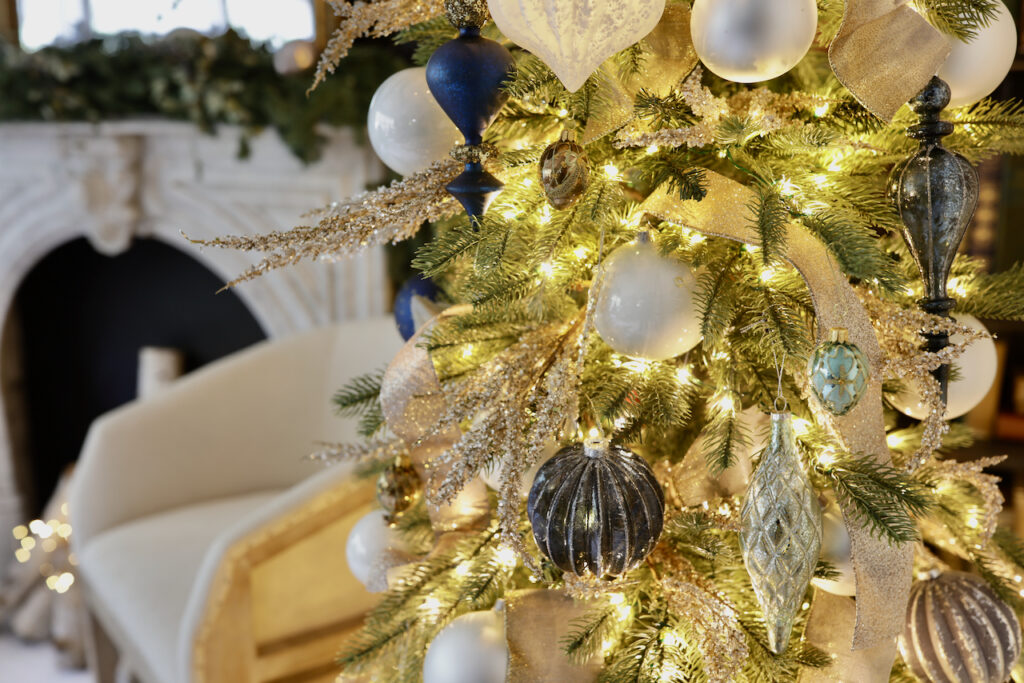Close-up shot of a Christmas tree decorated with assorted white and blue ornaments