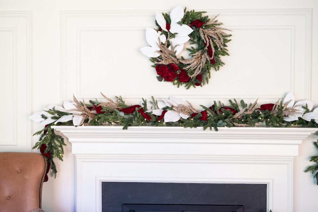 Southern Christmas-inspired wreath and garland decor on mantel