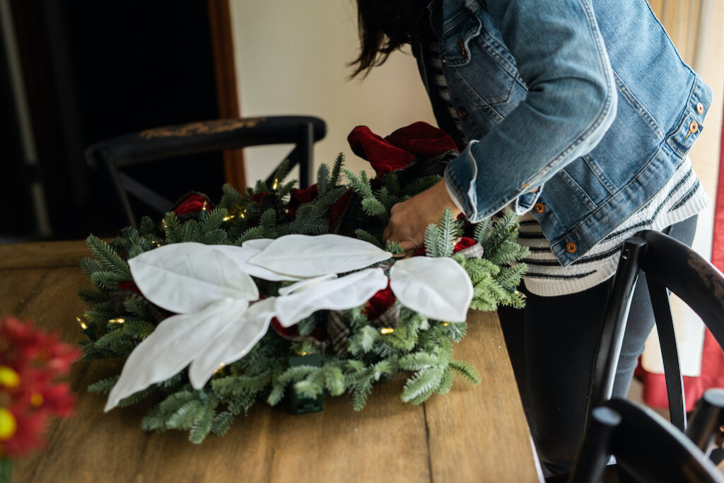 christmas wreath with ribbon and magnolia flower picks