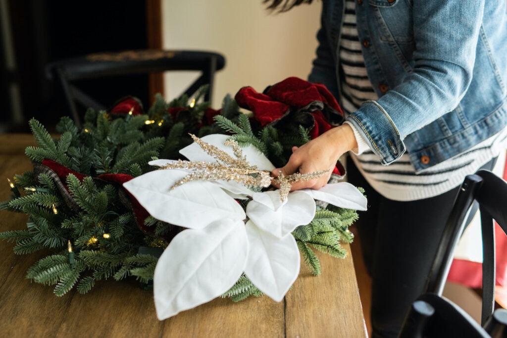christmas wreath with ribbon, magnolia picks, metallic plume pick
