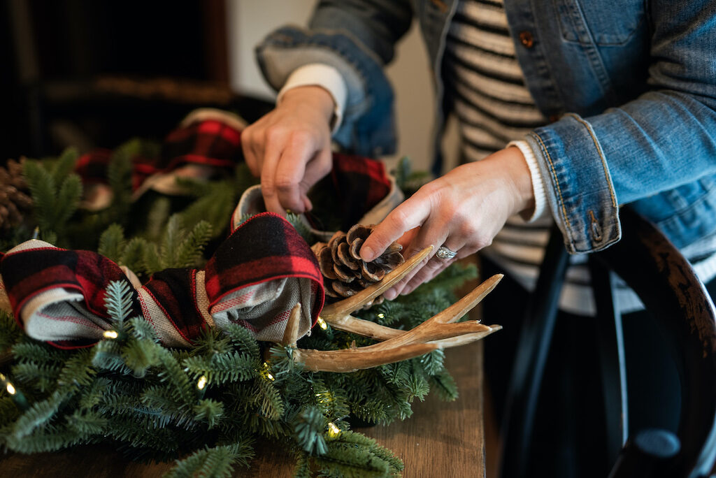 add ribbons, antler picks, and pinecones as accents to christmas wreath