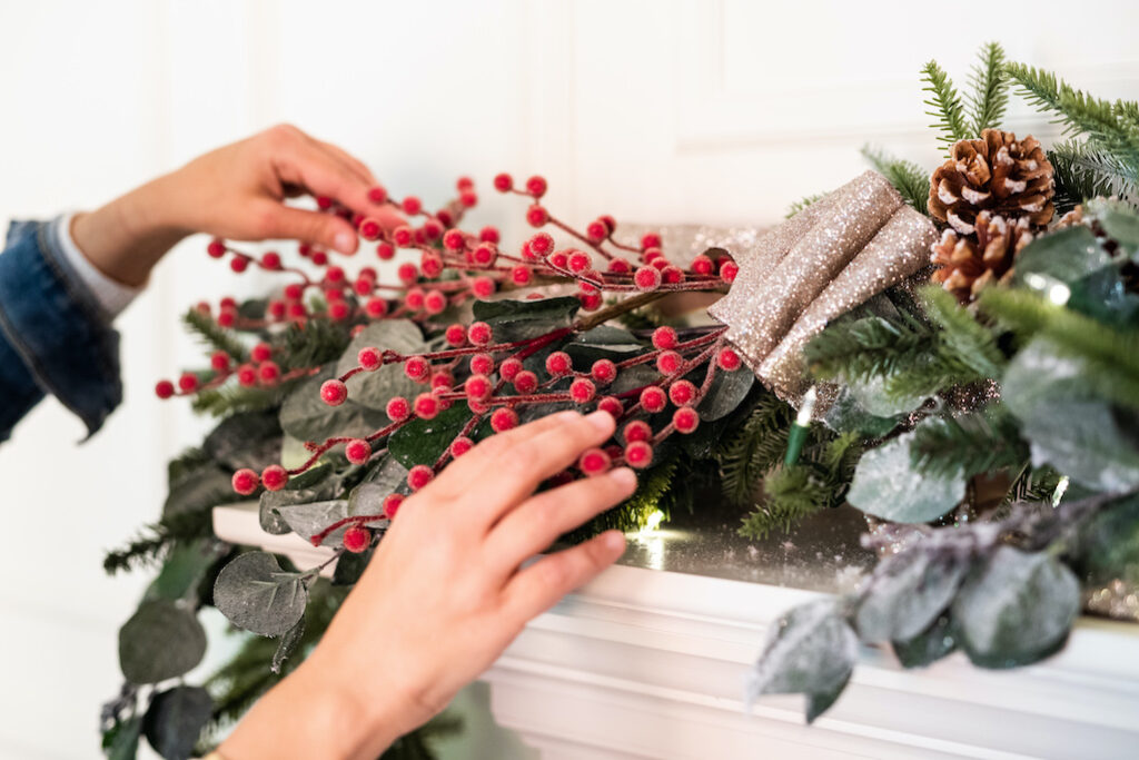 red berry picks, scalloped bow, pinecones, eucalyptus picks as garland decoration