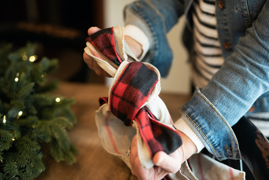 layered ribbons used to make a bow decor for christmas wreath