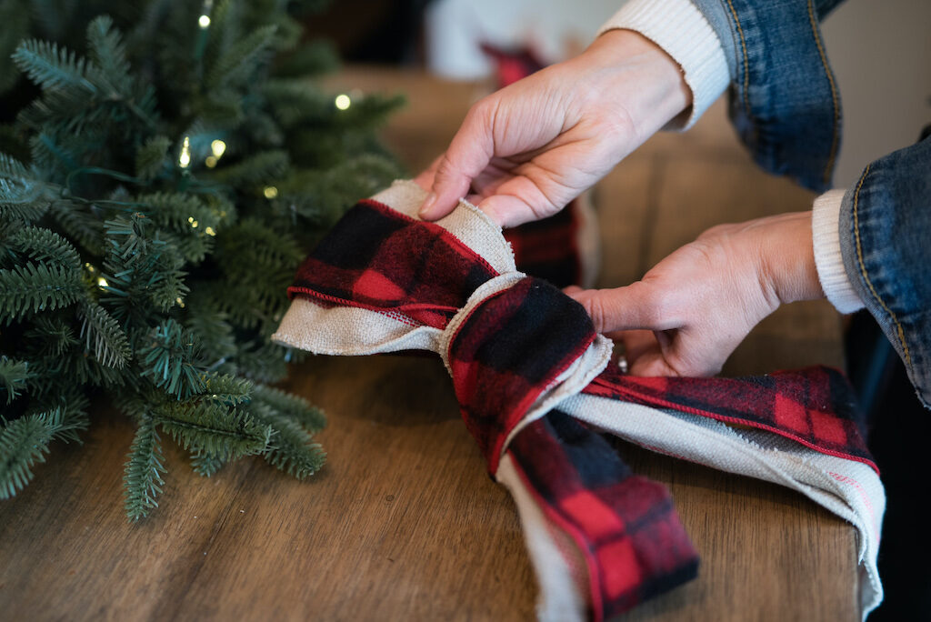 creating a large bow with ribbons for christmas wreath