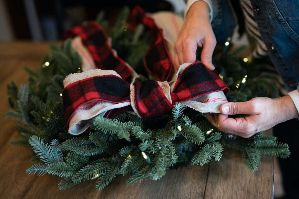 tuck ribbons around the christmas wreath for decor