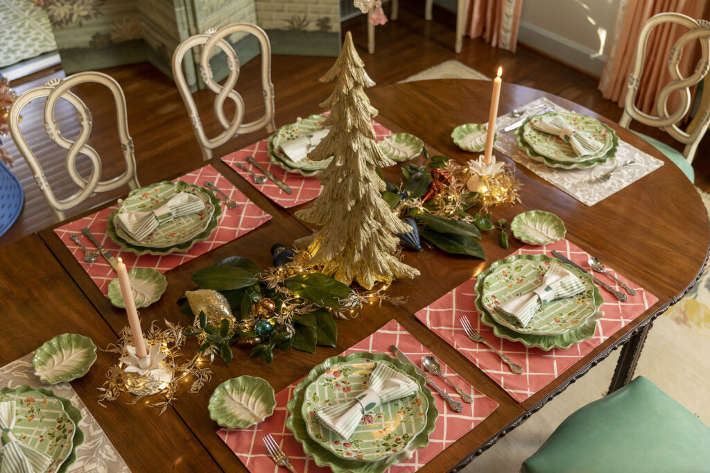 christmas table decorations with mini tree, candles, and ornaments
