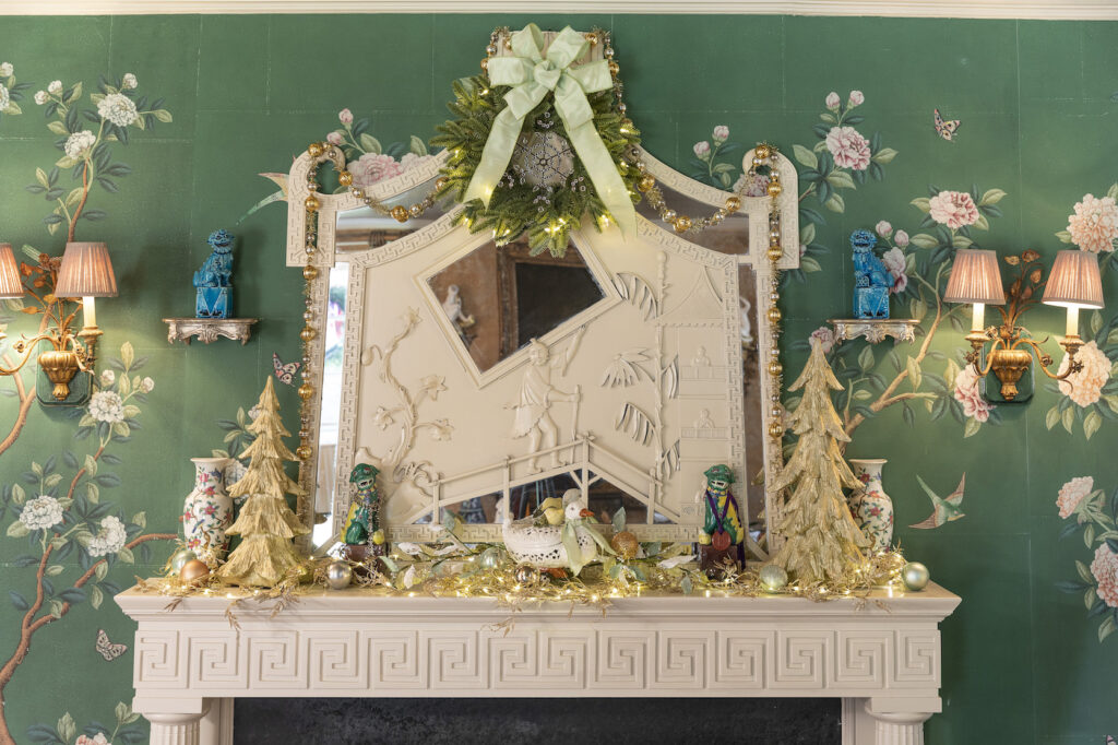mantel with christmas wreath and mini trees