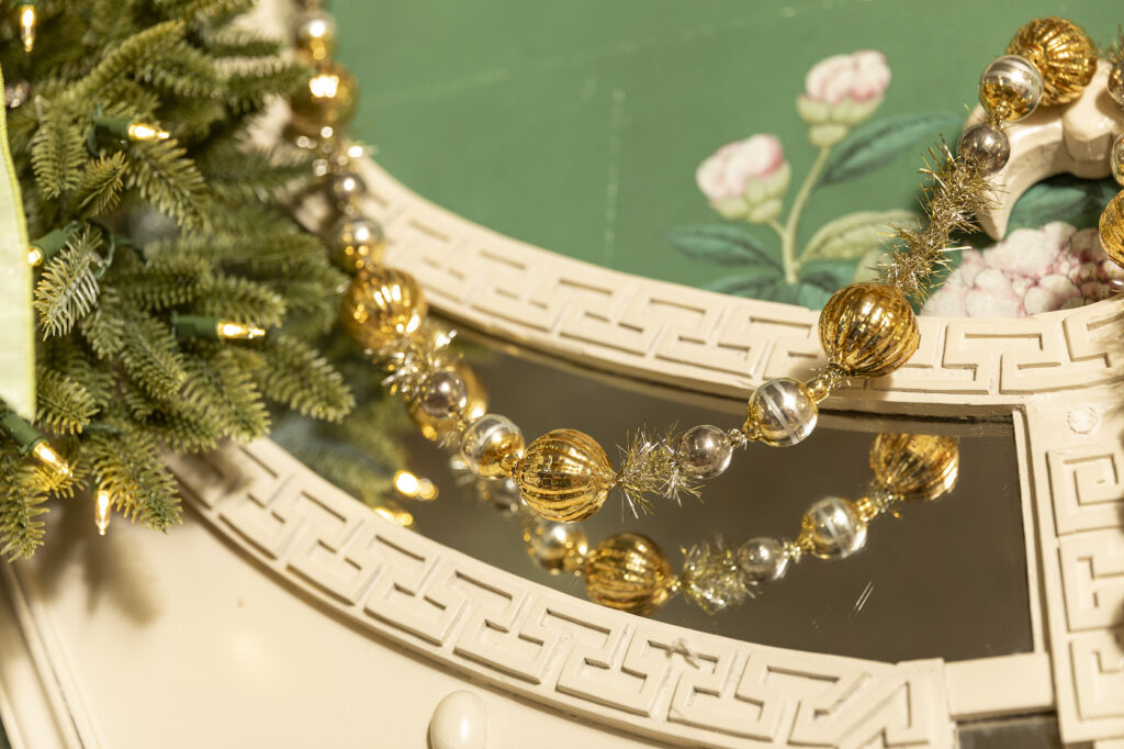 gold glass garland on mantel