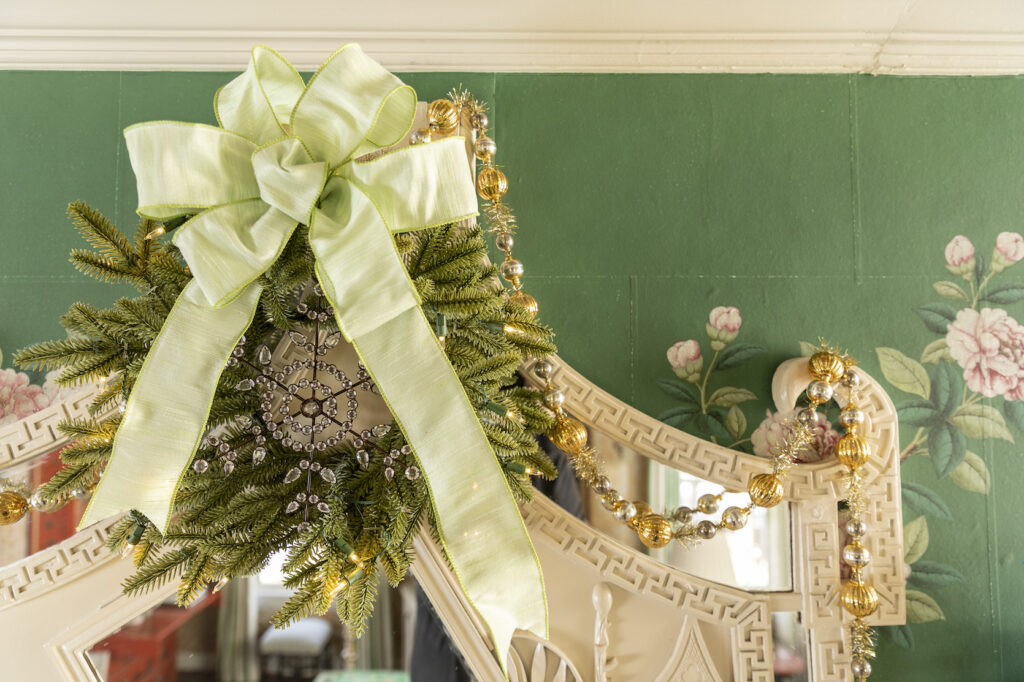 christmas wreath decorated with ribbon