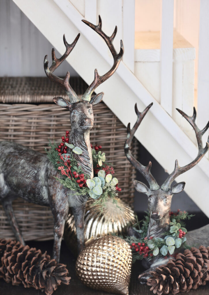 deer figures, pinecones, and ornaments for woodland christmas theme