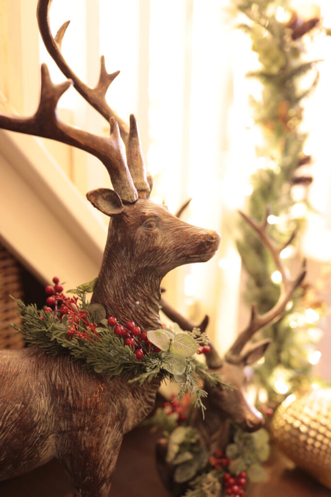 deer statue with wreaths