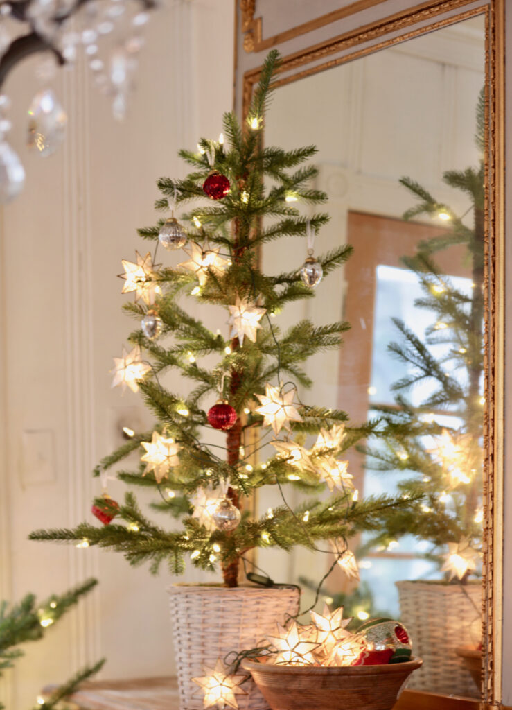 small tree with star garland and vintage inspired christmas theme