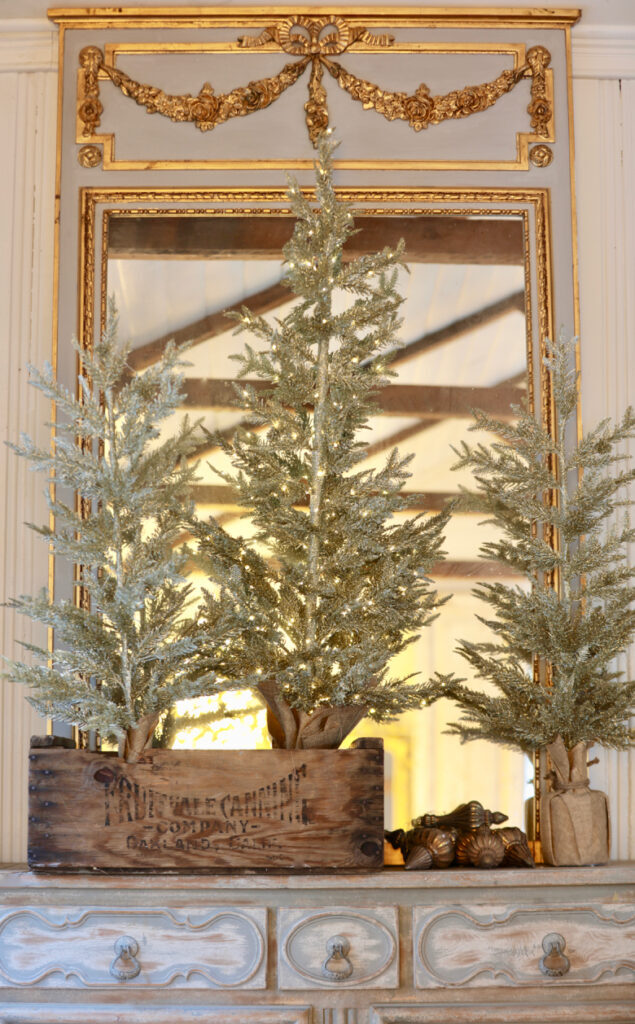 small trees on console table