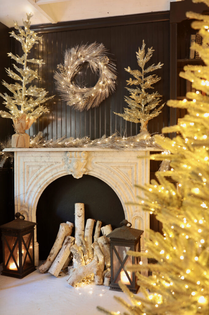 christmas pre-lit trees, wreath, garland on mantel
