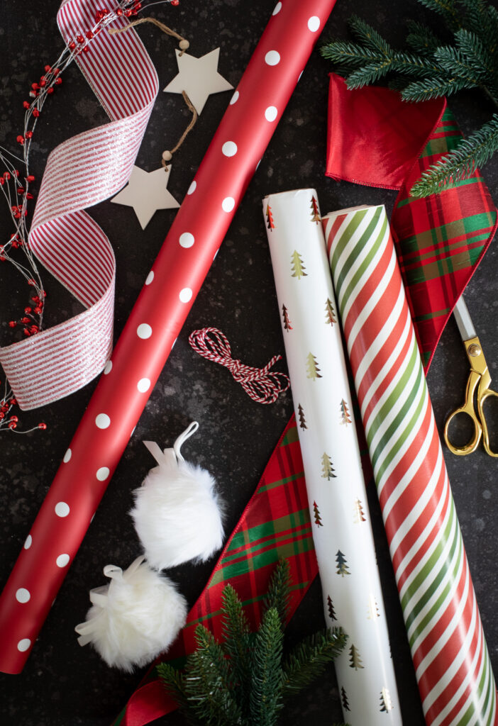 assorted christmas gift wrappers and ribbons