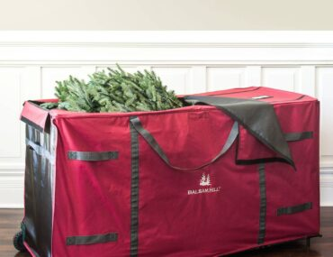 Opened Balsam Hill Rolling Multipurpose Greenery Bag with Christmas foliage inside