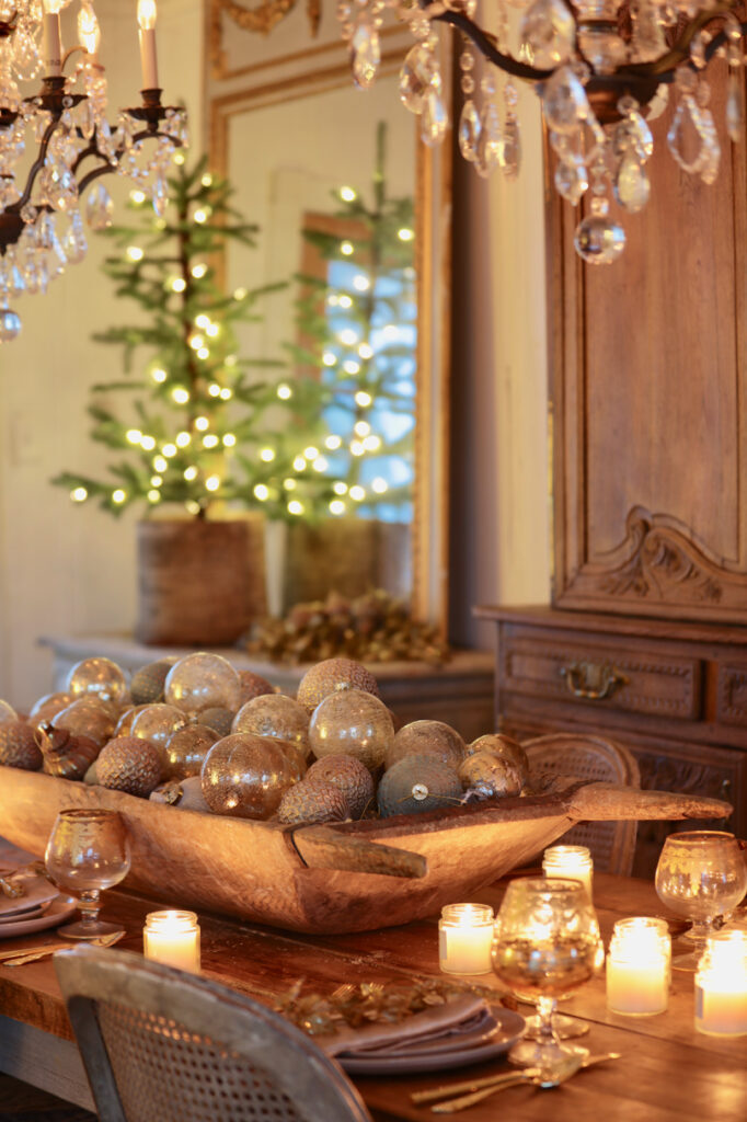 wooden bowl with balsam hill burnished metal ornaments used as christmas table centerpiece