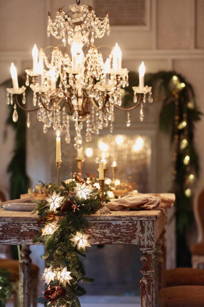 balsam hill mixed evergreen garland and capiz star garland as table centerpiece decor