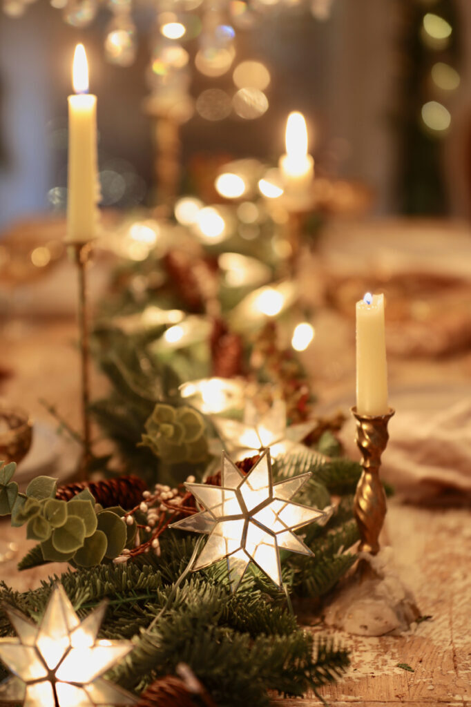 table centerpiece decorating idea with garland, stars, and candles