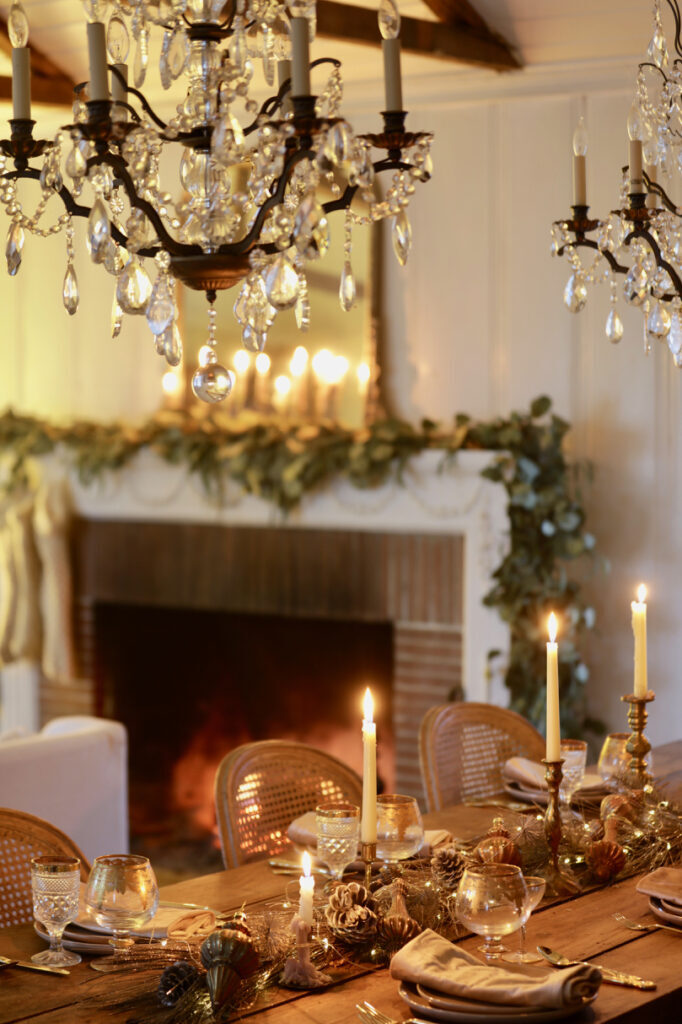 christmas table decoration with champagne pine garland