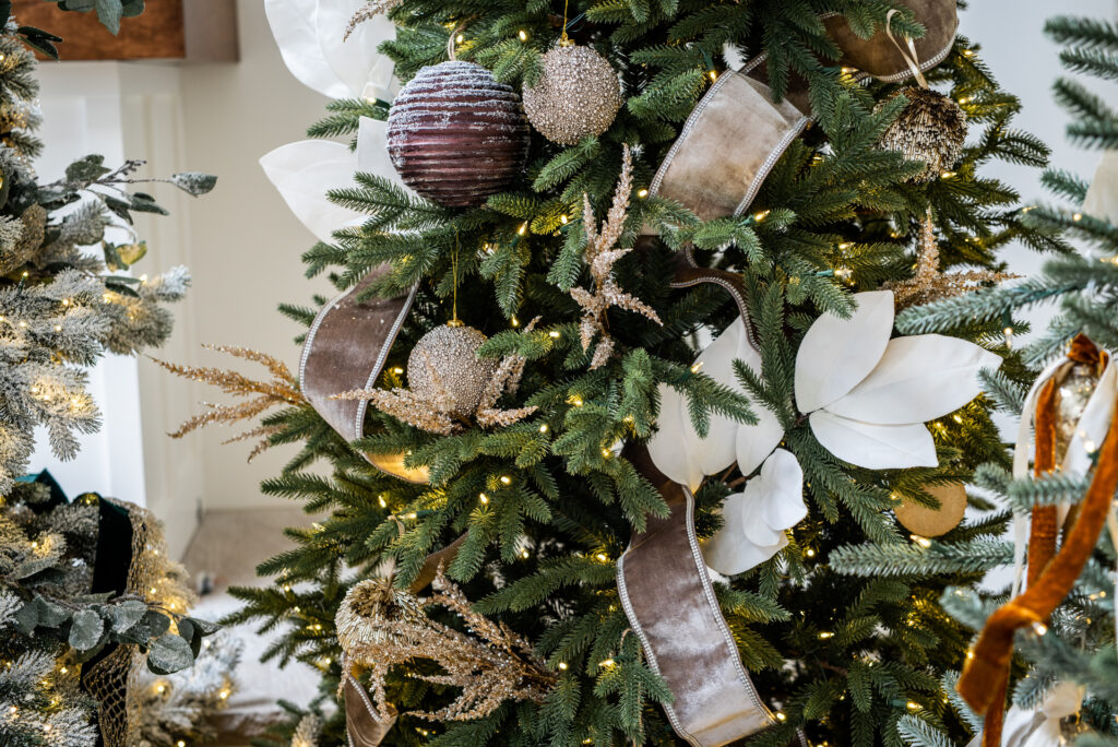 Close-up shot of a Christmas tree with ribbons and assorted ornaments
