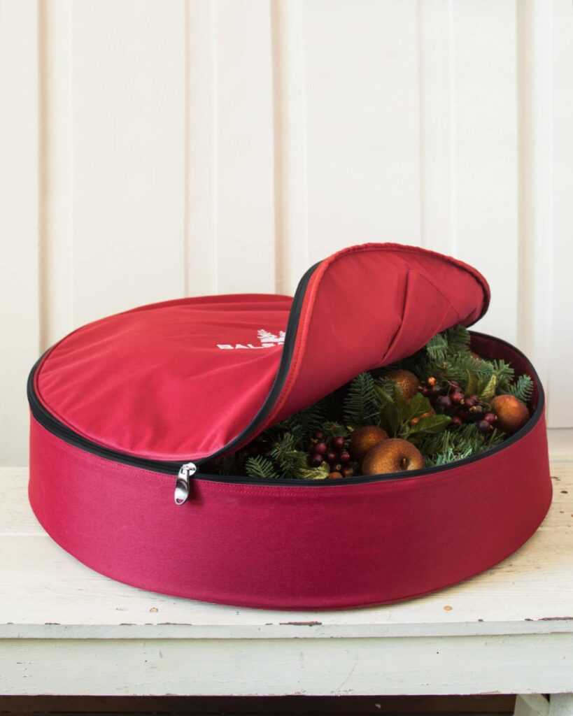 Opened Balsam Hill Small Wreath Storage Bag with wreath inside