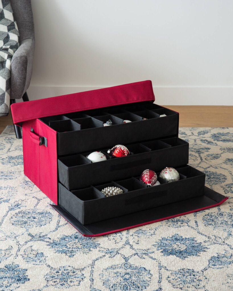 Opened Balsam Hill 72-Piece Christmas Ornament Storage Box with red and white ornaments inside
