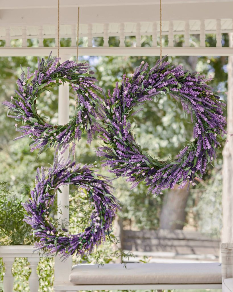 Balsam Hill Provencal Lavender wreaths of different sizes hanging on porch ceiling