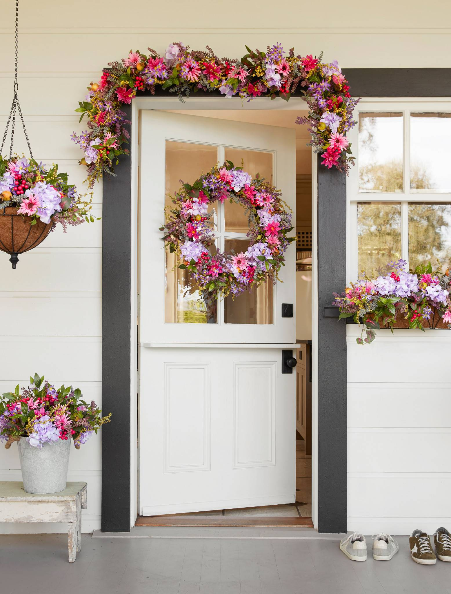 Balsam Hill Outdoor-safe Vibrant Summer Bloom floral wreath, garland, hanging basket, potted foliage, and window box on front door
