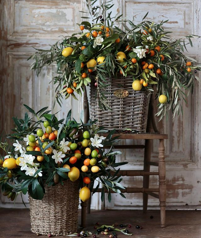 Balsam Hill Villa Cucina artificial arrangement in basket beside a similar fresh arrangement by Courtney of French Country Cottage