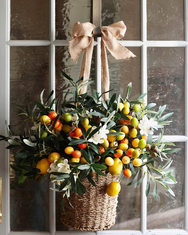 Balsam Hill Villa Cucina artificial arrangement with olive leaves, kumquats, and lemons, set in a hanging basket with burlap bow