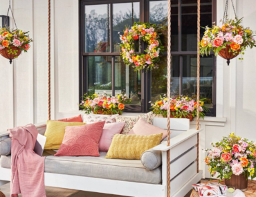 patio with bright artificial flowers and outdoor furniture