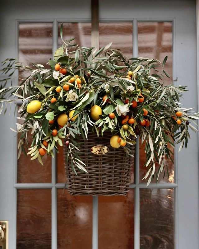 Fresh arrangement of olives, olive leaves branches, lemons, and kumquats by Courtney of French Country Cottage