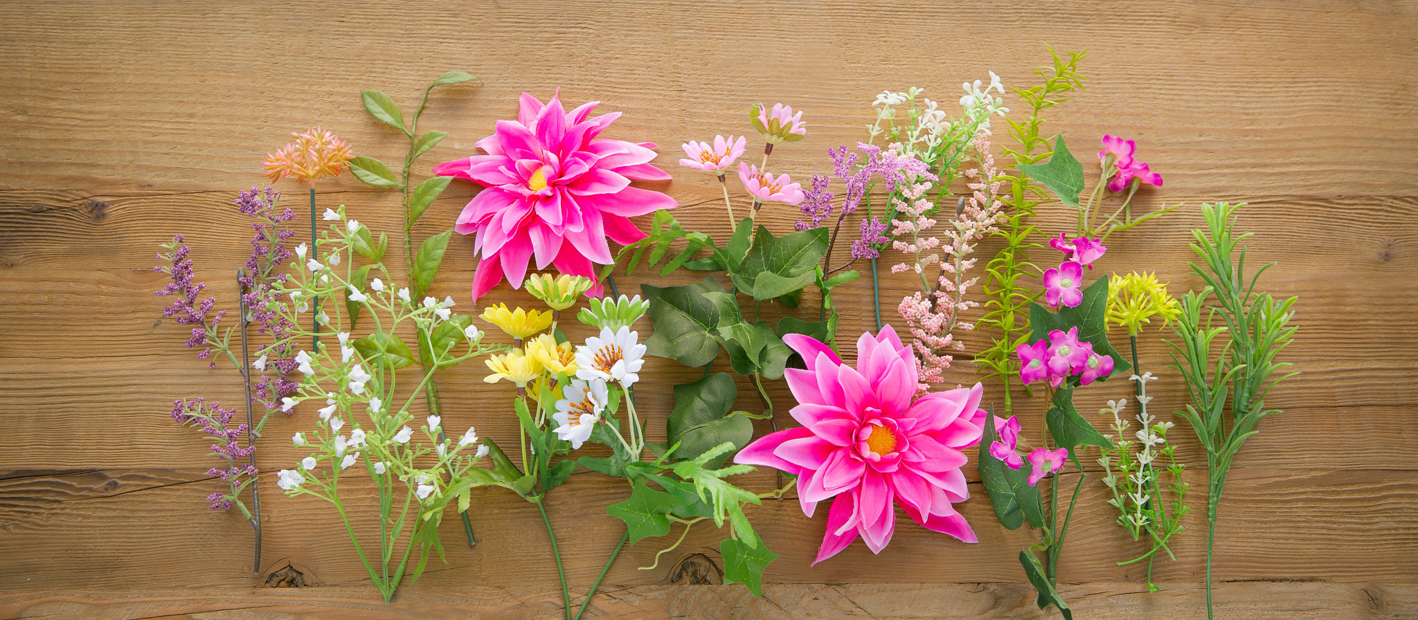 Balsam Hill Artificial Flowers flatlay on wooden table