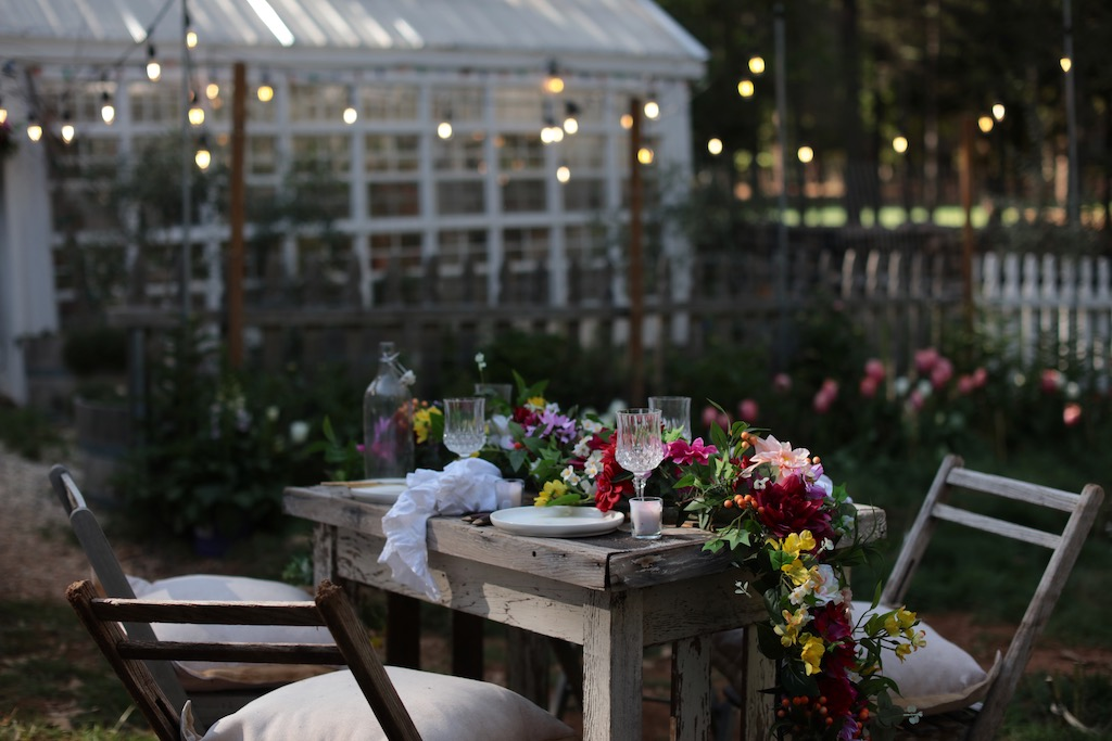 spring decorating idea for al fresco dining table setup with Balsam Hill artificial flowers as centerpiece