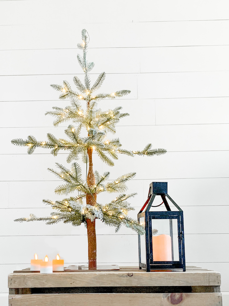 Balsam Hill LED Rechargeable Votive Candles, Balsam Hill Frosted Alpine Balsam Fir Tabletop Christmas Tree, and Balsam Hill Black Lantern with LED Candle