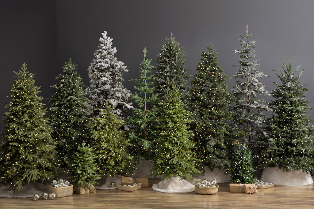A lineup of different Balsam Hill artificial Christmas trees