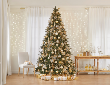 Silver and gold Christmas tree by the bar